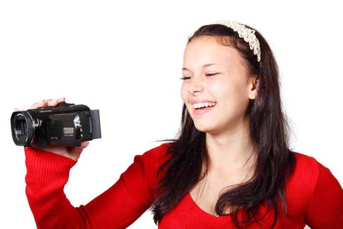 best camcorder 2019: a woman holding a camcorder