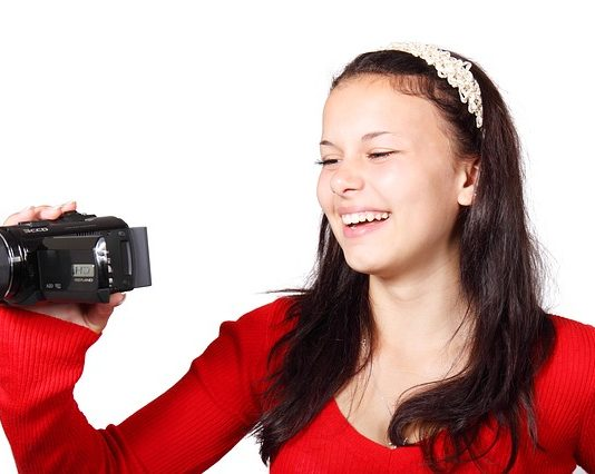 lady holding a HD camcorder